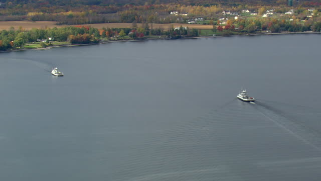 WS AERIAL ZI ZO View of two Grand Isle Ferries moving in bay / Vermont, United States