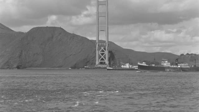 WS View of Two large boats traveling in ocean and background golden gate bridge under construction