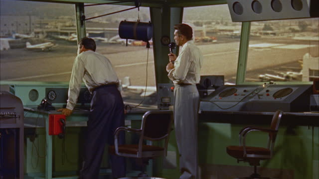 ms view of two operatives in airport control tower  - control stock videos & royalty-free footage