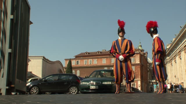 ws view of two swiss guards at vatican entrance / rome, italy  - swiss guard stock videos and b-roll footage