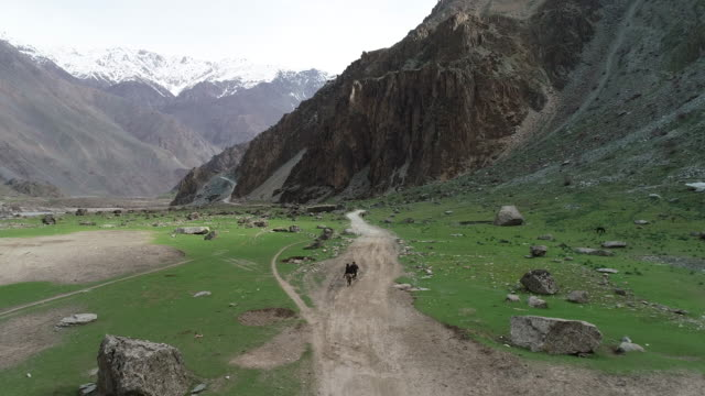 view of two tajiks walking through pamir plateau - steep stock videos & royalty-free footage
