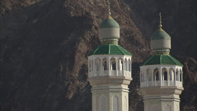 ms view of two white minaret towers with  green dome roof / muscat, gorverorate of muscat, oman - crescent stock videos & royalty-free footage