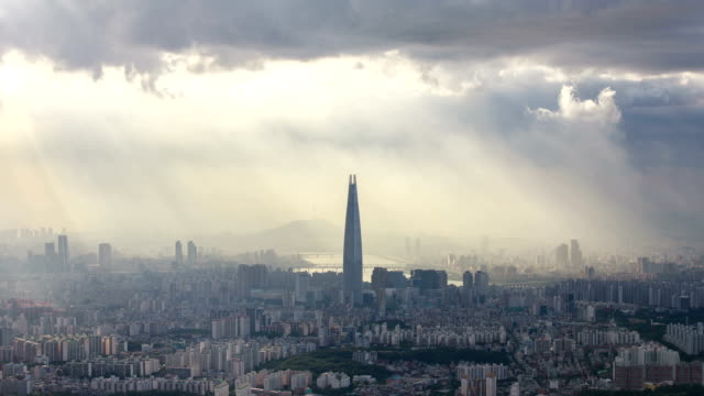 View of Tyndall phenomenon on downtown district of Seoul and Lotte World Tower (the tallest building in Korea)