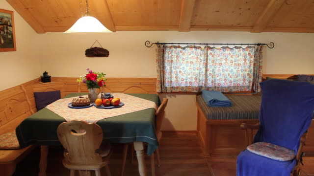 MS View of Typical bavarian living room with fruits and cake on table / Lenggries, Bavaria, Germany