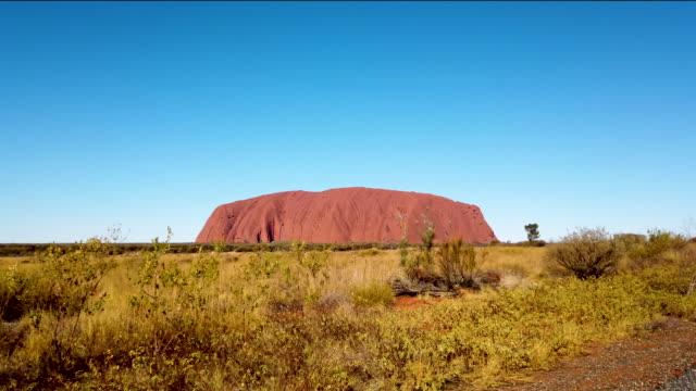 view of uluru as seen from the designated viewing area on august 13, 2019 in the uluru-kata tjuta national park, australia. the uluru-kata tjuta... - 12 13 years stock videos & royalty-free footage