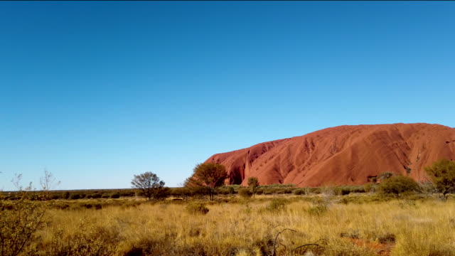 view of uluru as seen from the designated viewing area on august 13, 2019 in the uluru-kata tjuta national park, australia. the uluru-kata tjuta... - エアーズロック点の映像素材/bロール