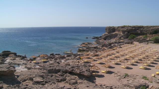 ws ha view of umbrellas and deckchairs beach rhodes island / rhodes, dodecanese islands, greece - rhodes dodecanese islands stock videos & royalty-free footage