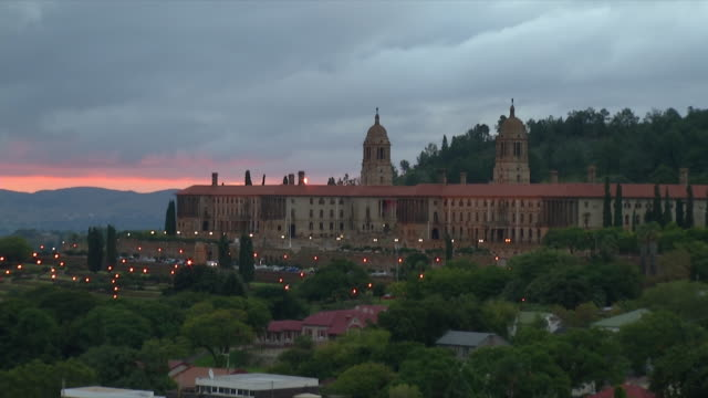 ws view of union buildings with heavy grey skies in background at sunset / pretoria, gauteng, south africa  - pretoria stock videos & royalty-free footage