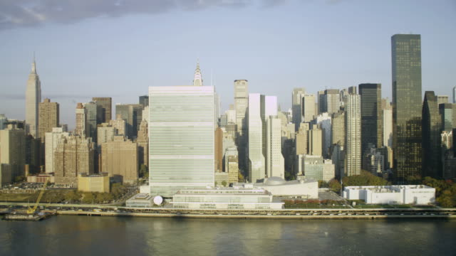 'WS AERIAL View of United Nations from East river / New York City, United States'