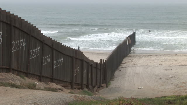 view of united states border fence in san diego united states - fence stock videos & royalty-free footage