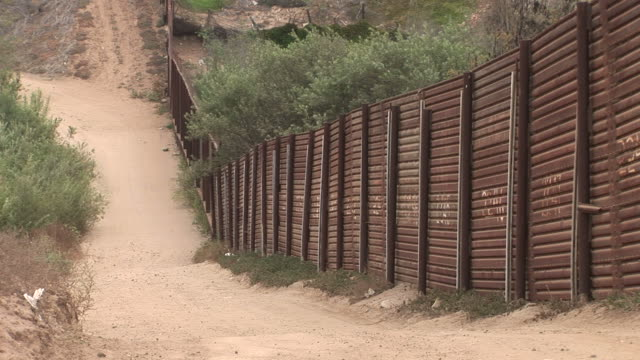 view of united states border fence in san diego united states - international border barrier stock videos & royalty-free footage