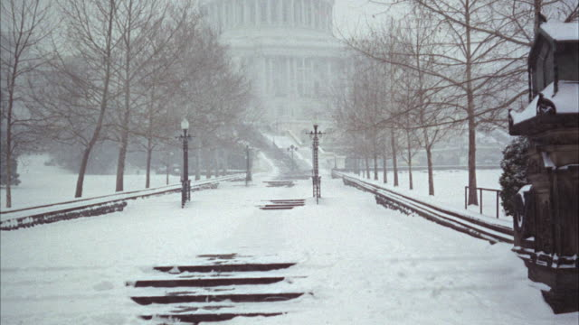 ws pan tu view of united states capitol building in winter / usa - anno 1968 video stock e b–roll