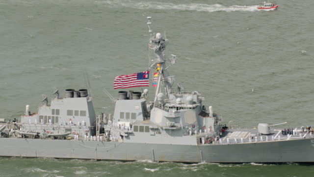 ws zi zo aerial view of united states flag on us navy ships / new york city  - military ship stock videos & royalty-free footage