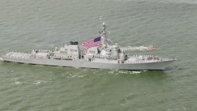 ws aerial view of united states flag on us navy ships / new york city  - us navy stock videos & royalty-free footage