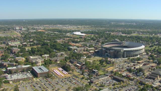 WS AERIAL View of University of Alabama campus buildings and Bryant Denny Stadium football stadium / Tuscaloosa, Alabama, United States