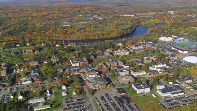 ws arieal view of university of maine campus in front of river / maine, united states - new england usa stock videos & royalty-free footage