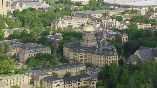 ws aerial pov view of university of notre dame / notre dame, st. joseph county, indiana, united states - indiana stock videos & royalty-free footage