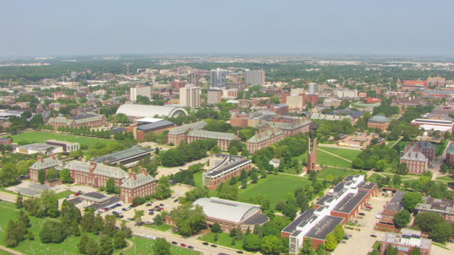 ws aerial pov view of university of urbana-champaign and mcfarland memorial bell tower with cityscape / champaign, illinois, united states - illinois stock videos & royalty-free footage