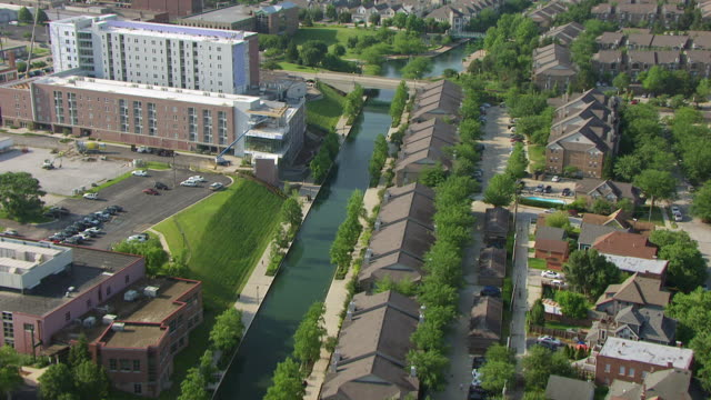 WS TU AERIAL POV View of Upper Canal with downtown in background / Indianapolis, Marion County, Indiana, United States
