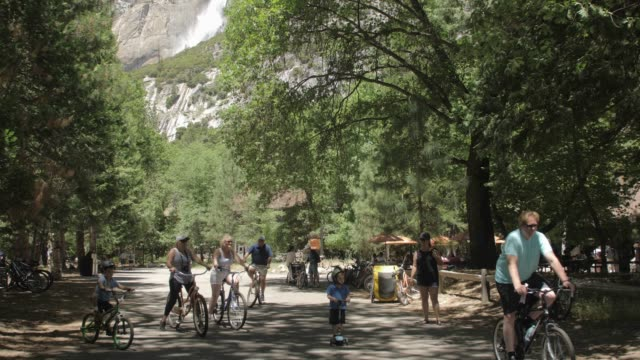 view of upper yosemite falls overlooking yosemite village, yosemite national park, unesco world heritage site, california, usa, north america - upper yosemite falls stock videos & royalty-free footage