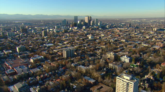 vidéos et rushes de ws pov aerial view of urban residential area approaching downtown denver - colorado