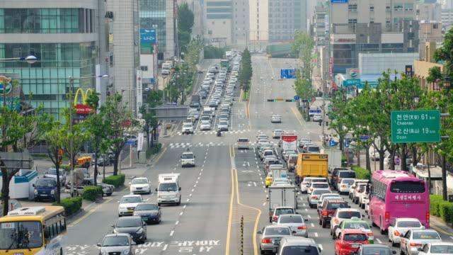 ws t/l view of urban road at motgol intersection on gyeongsudaero road / suwon, gyeonggi do, south korea  - suwon stock videos and b-roll footage