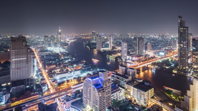 t/l ws ha zo view of urban skyline at night / bangkok, thailand - zoom out stock videos & royalty-free footage