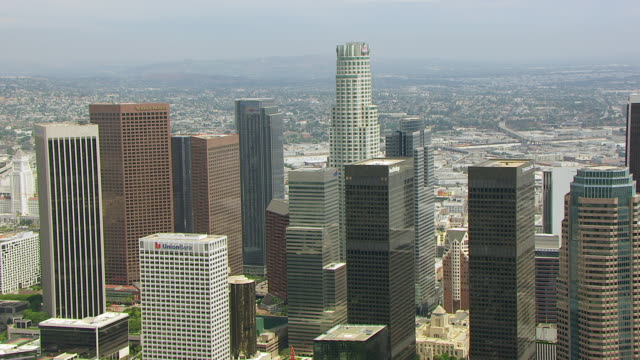 ws aerial pov view of us bank tower and skyscrapers in downtown los angeles / los angeles, california, united states - us bank tower stock videos & royalty-free footage