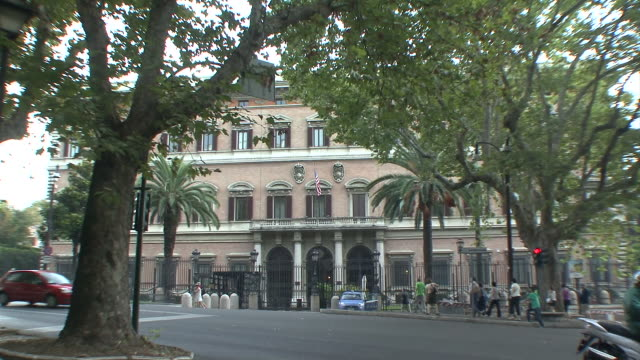 WS ZO View of US flag in front of American Embassy / Rome, Italy