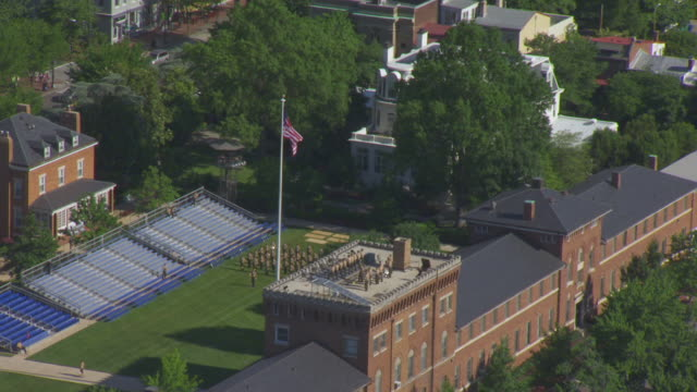WS ZO AERIAL POV View of US Flag with Marine Barracks / Washington DC, United States