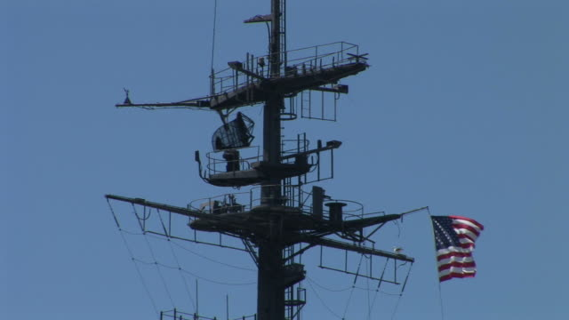 View of U.S National Flag flapping in the mast of a ship in San Diego United States
