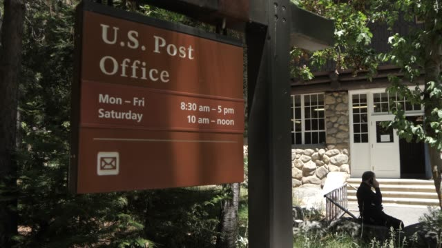 view of us post office in yosemite village, yosemite national park, unesco world heritage site, california, united states of america, north america - post office stock videos & royalty-free footage