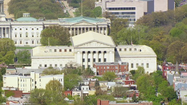 ms zo tu aerial pov view of us supreme court and us capitol / washington dc, united states  - us supreme court building stock videos and b-roll footage