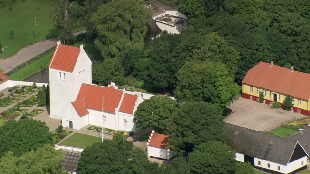 WS AERIAL ZI ZO View of Vaerslev and white church / Vestsjaelland, Denmark