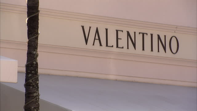 view of valentino sign and logo on shop exterior / palm beach, florida, usa - valentino designer label stock videos & royalty-free footage