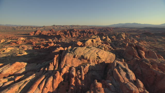 ws aerial view of valley of fire with red rock formations with morning light / nevada, united states - nevada stock-videos und b-roll-filmmaterial