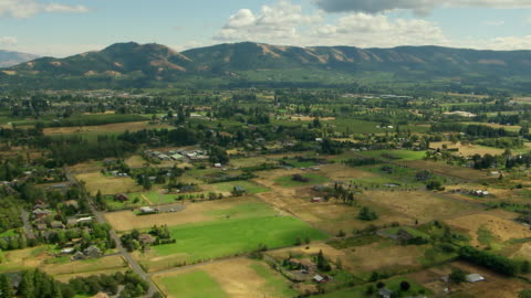 ws aerial view of valley with houses and farmland in columbia river gorge / oregon, united states - valley stock videos & royalty-free footage