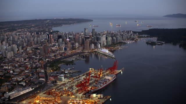 aerial view of vancouver from above the vancouver harbour at dusk - ship stock videos & royalty-free footage