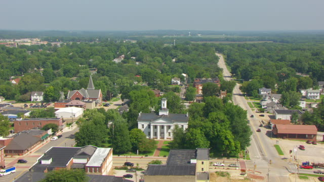 ws aerial pov view of vandalia state house, cars moving on street / vandalia, fayette county, illinois, united states - local politics stock videos & royalty-free footage