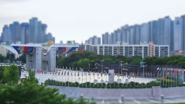 ws t/l view of various national flag swaying in  breeze at  peace gate of olympic park / seoul, south korea - national flag stock videos and b-roll footage