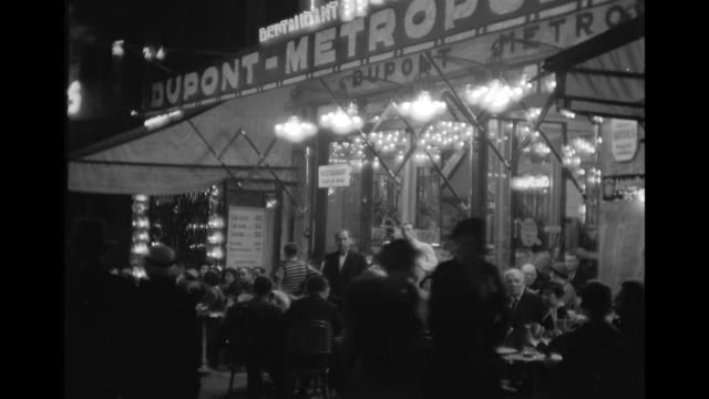 vídeos y material grabado en eventos de stock de wst/l view of various street shop of paris at nightstreet scenes/ paris, france - 1930