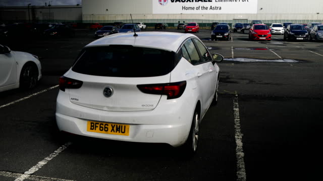stockvideo's en b-roll-footage met view of vauxhall's assembly plant in ellesmere port on march 6, 2017 in ellesmere port, england. french car giant psa group have announced today the... - sale