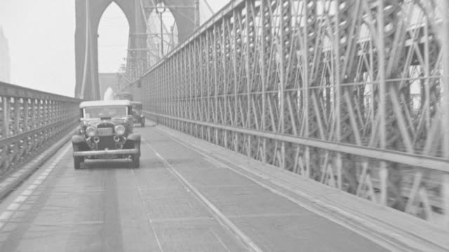 WS POV View of vehicle driving across the Brooklyn Bridge