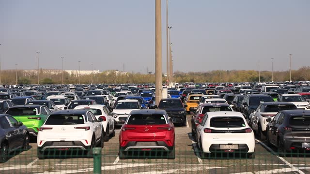 view of vehicles waiting for delivery in the parking lot at the production plant of the french automotive constructor psa - stellantis on april 16 in... - parking stock videos & royalty-free footage