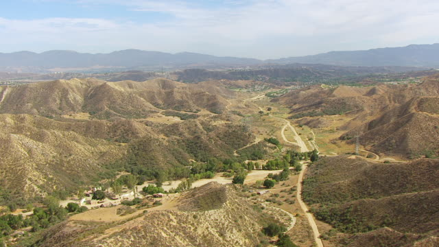 ws aerial pov view of veluzat motion picture ranch film studio and hills / santa clarita, california, united states - santa clarita video stock e b–roll