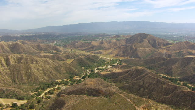 ws aerial pov view of veluzat motion picture ranch film studio at santa clarita valley / santa clarita, california, united states - santa clarita stock videos & royalty-free footage