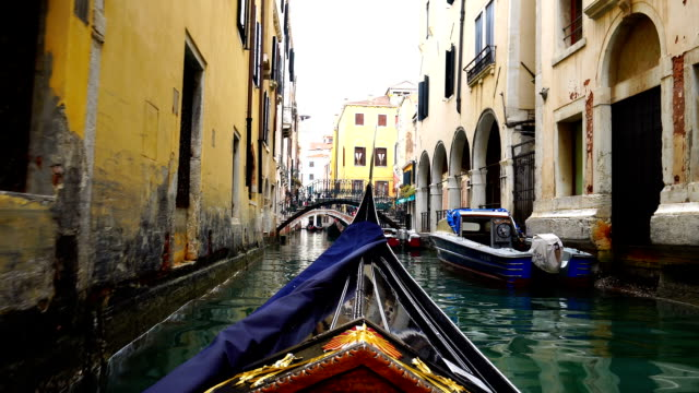 view of venice on a gondola - venice italy stock videos and b-roll footage