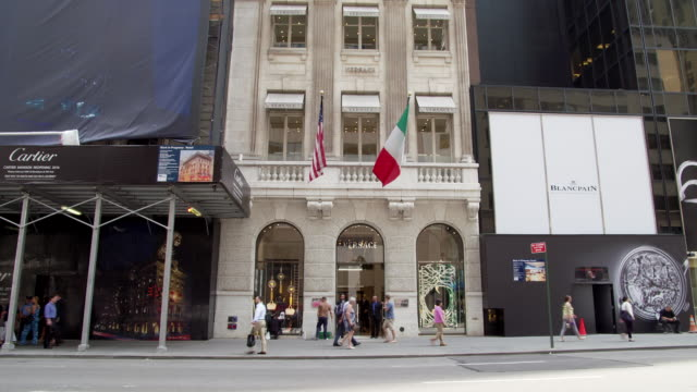 ms td view of versace store to streetscape at 647 fifth avenue / new york, united states - flagship store stock videos and b-roll footage
