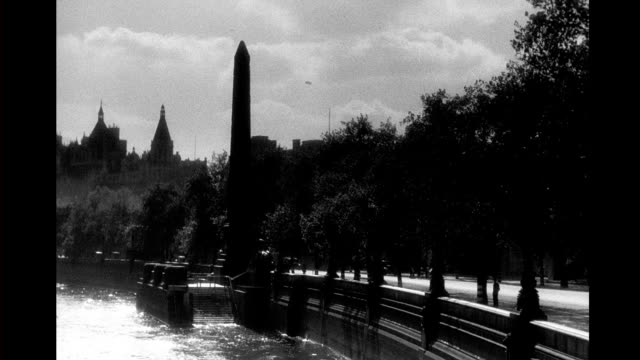 view of victoria embankment with cleopatra's needle. london embankment, cleopatra's needle on september 15, 1943 in london - obelisk stock videos & royalty-free footage