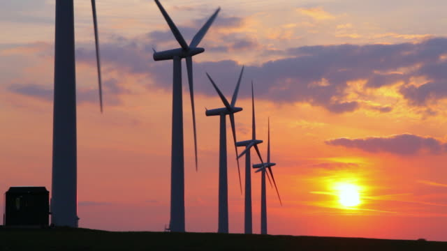 ws view of view of windturbines at sunset / swindon, wiltshire, united kingdom - five objects stock videos and b-roll footage
